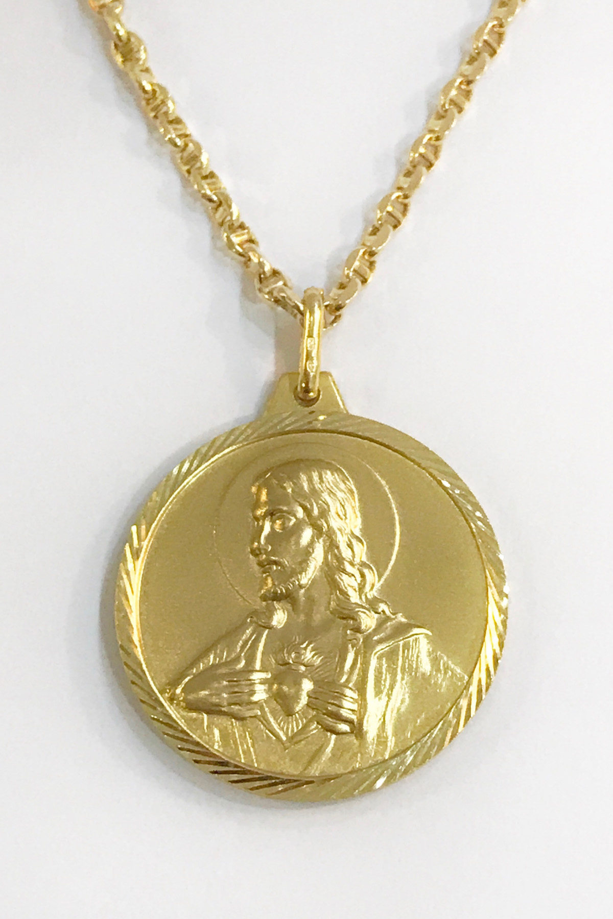 sacred heart gold pendant